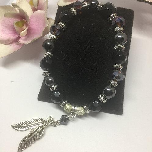 Black and smoky quartz bracelet with feathers charm