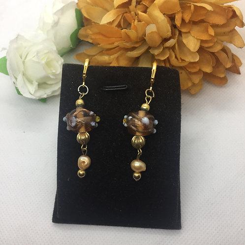 Gold elaborate drop earrings