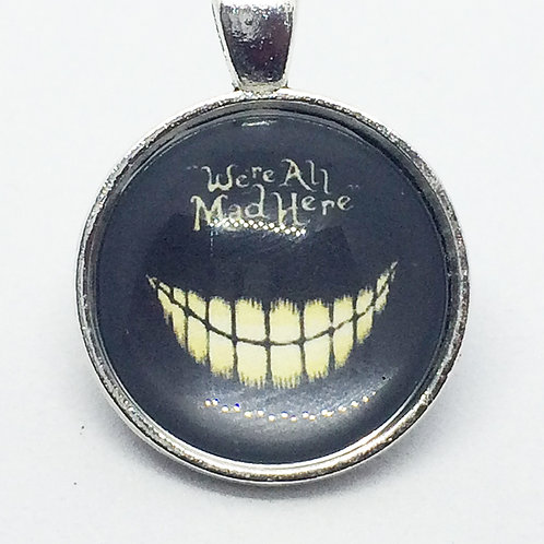 Alice in Wonderland 'We're all mad here' Round pendant