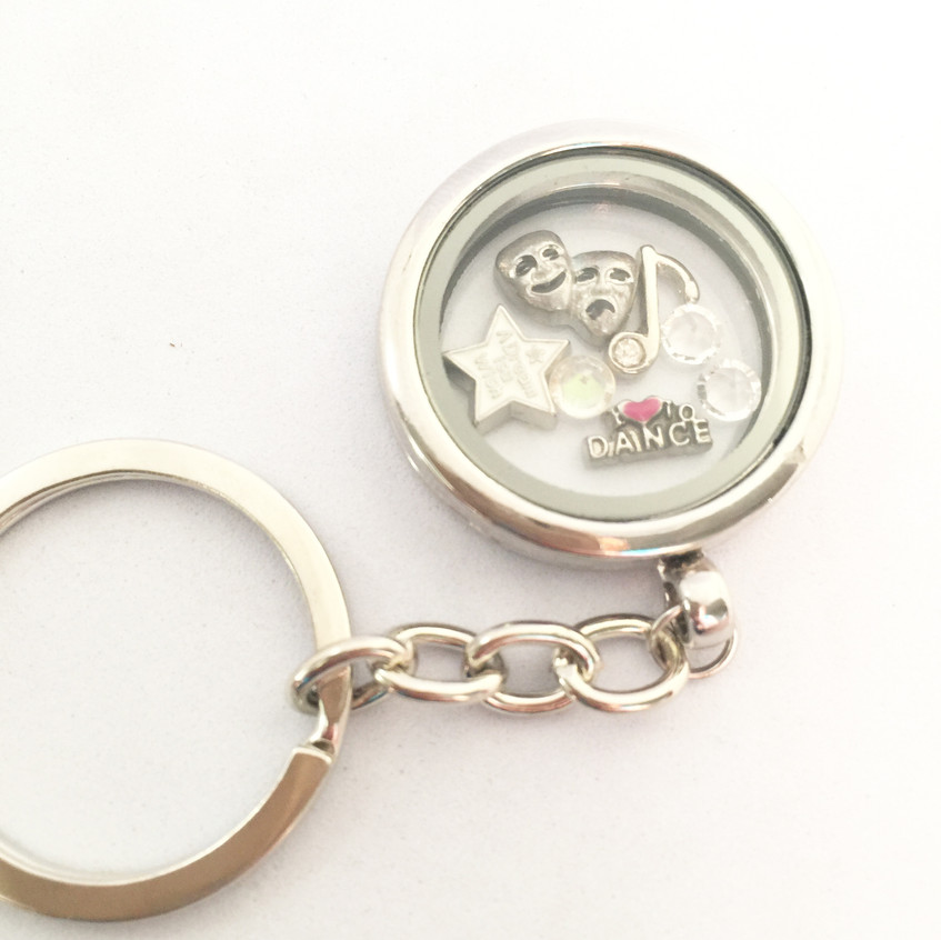 A selection of Theatre Themed Memory Locket keyrings