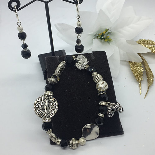 Black and silver bracelet with mask charm and matching black jet earrings