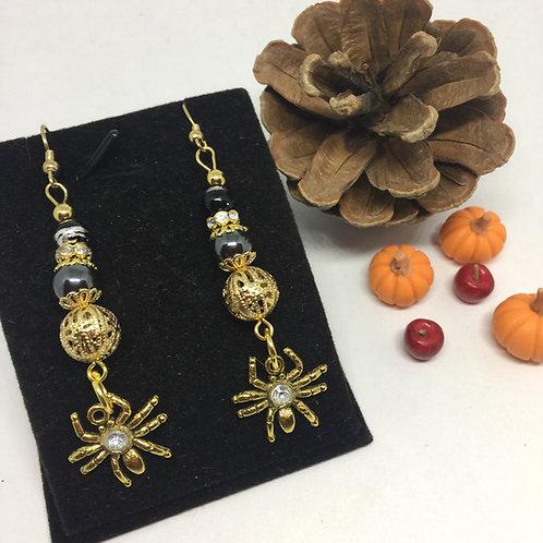 Gold Spider long drop earrings