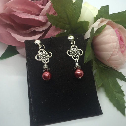 Burgundy artificial pearl and celtic symbol drop earrings