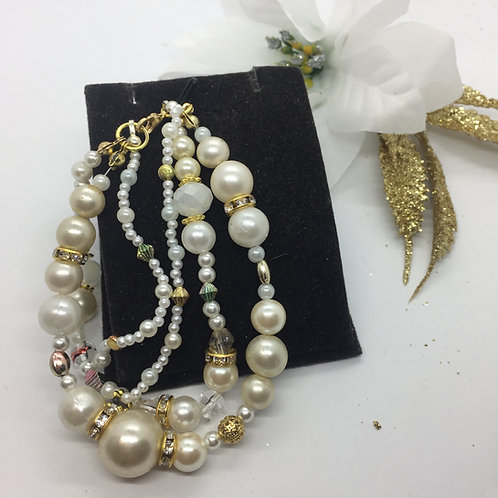 Triple string mixed pearls and gold bracelet