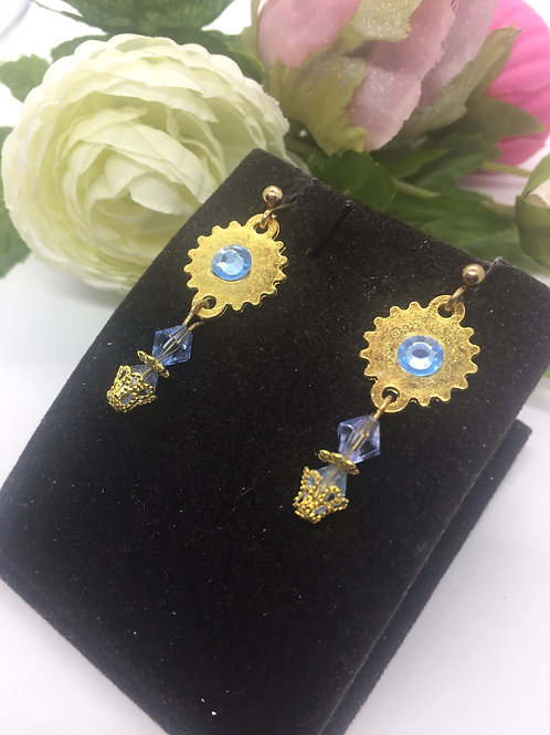 Gold cog and blue crystal double drop earrings