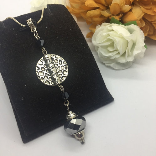 Silver circle and jet pendant