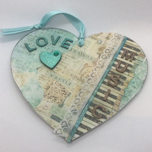 Decorated 'LOVE MUSIC' hanging heart