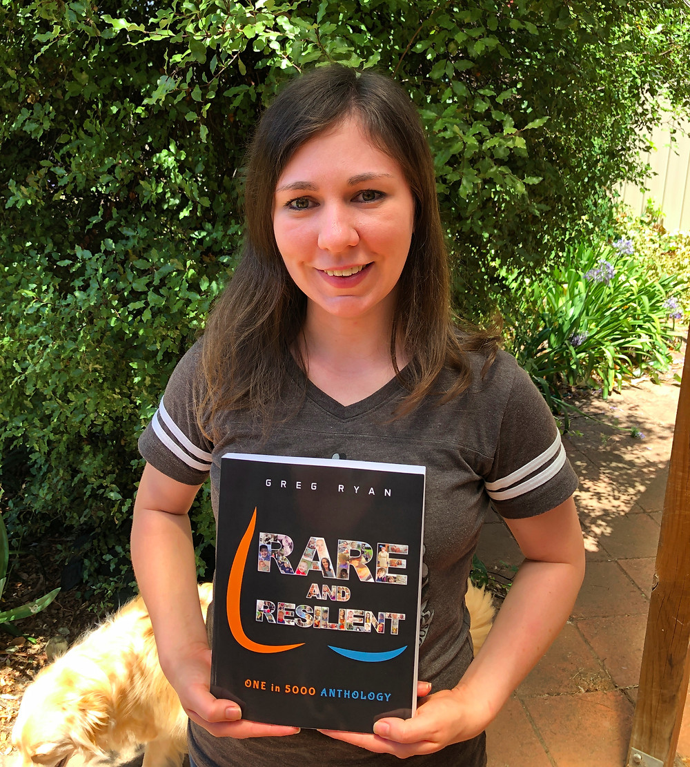 Meghan Douglass holding the book Rare and Resilient