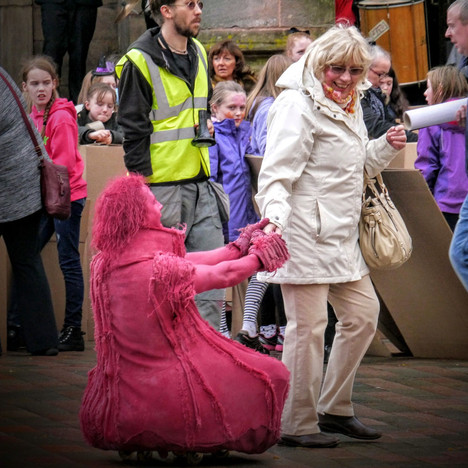 Pink people street theatre - copyright Colin Cunningham
