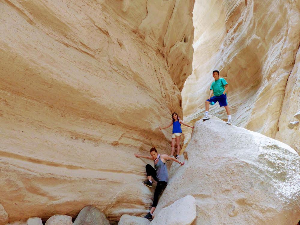 Santa Fe family on rocks.jpeg