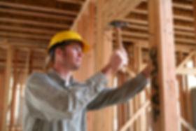 bigstock-Construction-Man-Using-Hammer-1