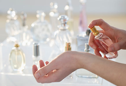 hand spraying perfume