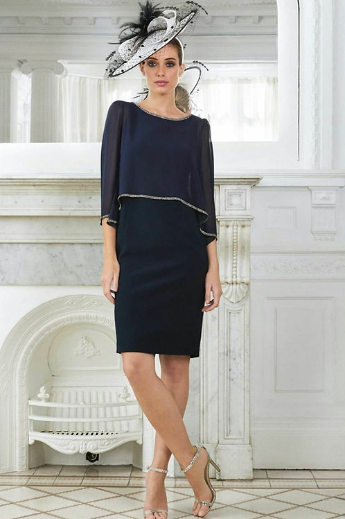 Luis Civit -Navy crepe fitted dress with built in chiffon cape.