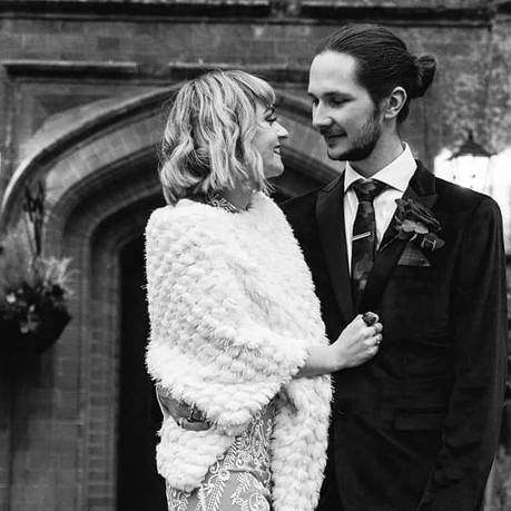 Clarice wearing a lace jumpsuit for her Rock n'Roll wedding