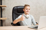boy-with-laptop-office_23-2148019075.jpg