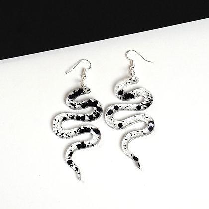 Black splatter snake earrings