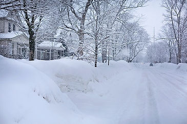 Snowy road with mounds of snow