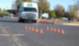 Transit bus and mini cones at bus driving course