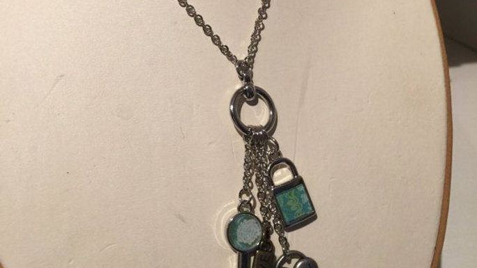 Silver tone charm necklace