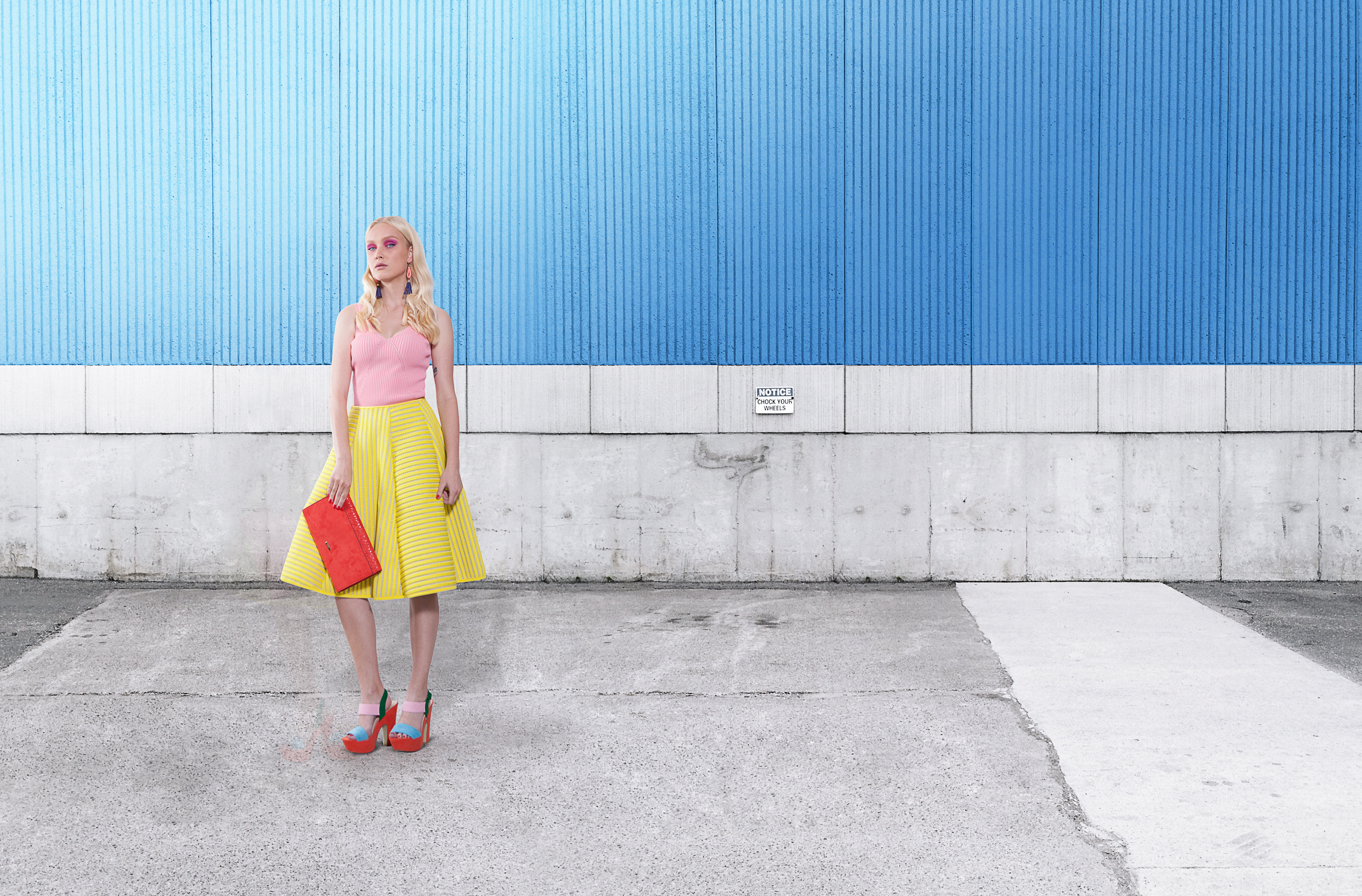 Fashion Model on Blue Wall
