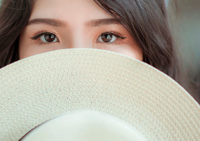 asian-woman-with-hat-covering-face_edite