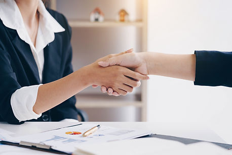 Businesswoman shaking hand for a complet
