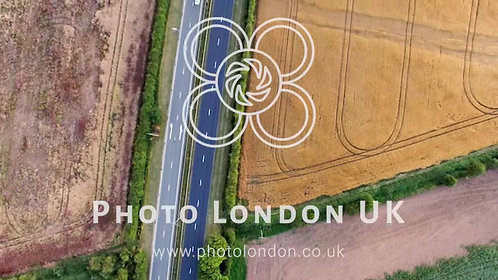 4K Aerial View Of A Traffic Driving On A Motorway Through The Countryside