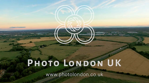 4K Aerial Shot Over Lush Green Fields And Meadows
