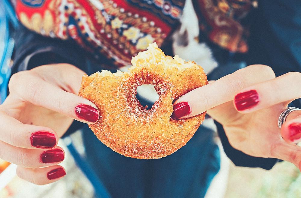 Lady holding donut