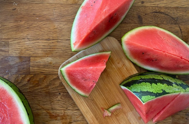 Watermelon cuts on wooden table