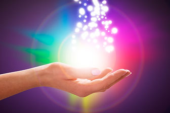 A Person's Hand Into Magical Healing Ene