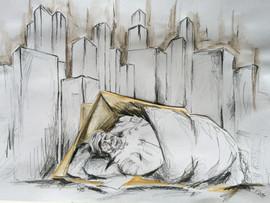 Un monsieur barbu dort dans la rue