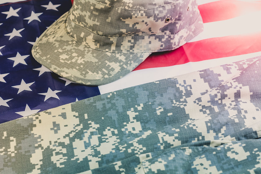 US flag with US military uniform over it