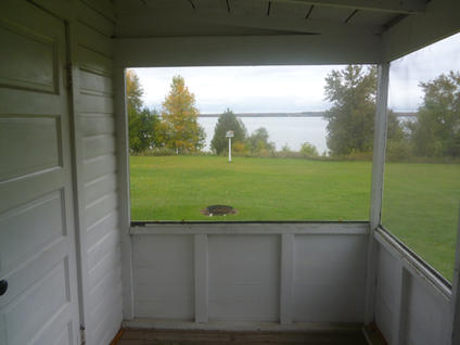 Cypress screened in porch with view