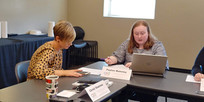 B-PC junior Peyton Maloney works with CEO Board Member Kelly Hamm