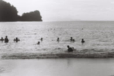 people swimming at the beach in trinidad