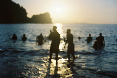 people swimming in the beach in trinidad and tobago