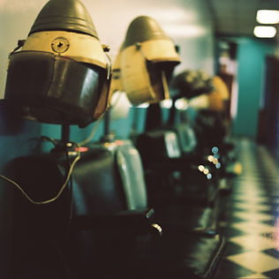 empty hair dryers in a salon