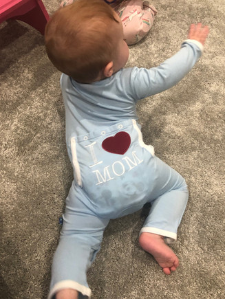 Go baby go! This little love is wearing the softest PJ's from KicKee Pants.