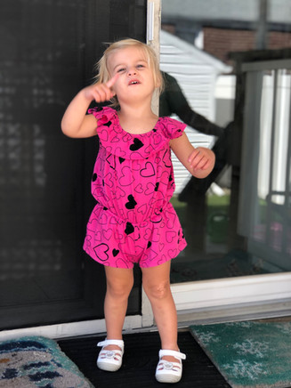 Look at this little doll in one of our Pink Peony rompers.  100% cotton.  Made in the USA!