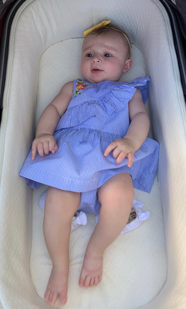 Hot summer days call for 100% cotton. This beautiful baby looks so cool in her Blu and Blue crossover ruffle striped dress and matching pant.