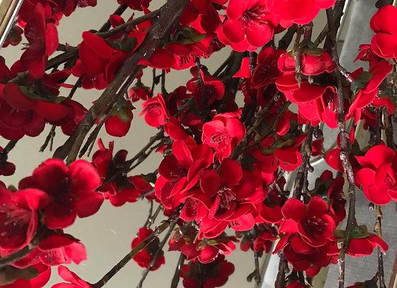 Red silk flowers