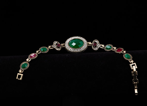 Bracelet with green, burgundy and clear accents