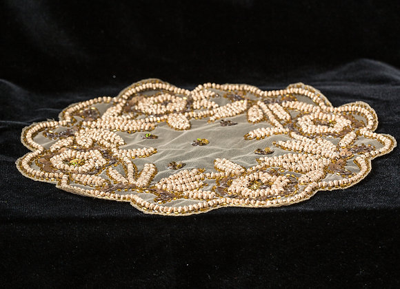 Gold hand beaded design doily