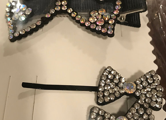 Set of bow shaped hair pins with rhinestones