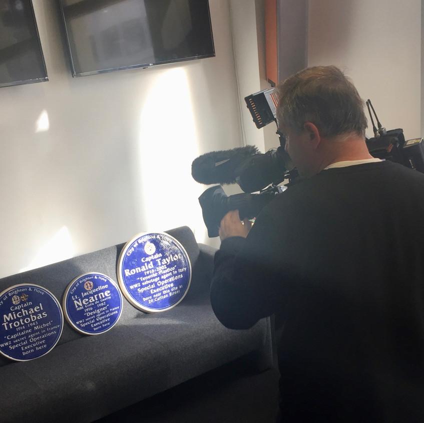 The four blue plaques