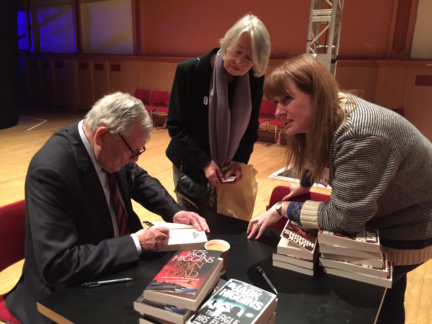 Harry signs books