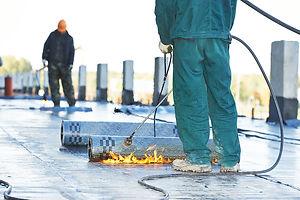 bigstock-Roofer-installing-Roofing-felt-