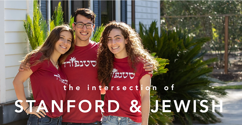 Three college students wearing red Stanford in hebrew shirts posing in front of the Hillel building on campus