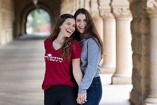 Two female college students laughing in the halls of the Stanford Quad
